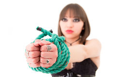 Woman in corset with hands tied focus on the front Stock Photography