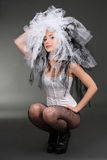 Woman in corset with material on head Stock Photography