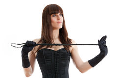Woman in a corset and  riding crop Royalty Free Stock Photo