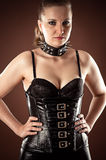 Woman in corset and spiked collar Royalty Free Stock Photo