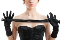 Woman in a corset and  whip Royalty Free Stock Images