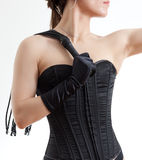 Woman in a corset and  whip Stock Photos