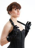 Woman in a corset and  whip Stock Image