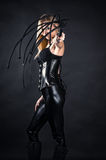 Woman in a corset with a whip in hands. Beautiful woman in a corset with a whip in hands royalty free stock image