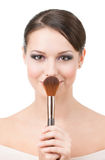 Woman with cosmetic brush. For powder, isolated on white Stock Images