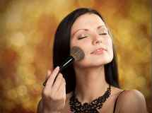 Woman with a cosmetic brush Royalty Free Stock Photo