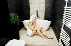 Woman with cosmetic cream in bathroom. Royalty Free Stock Photo