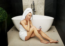 Woman with cosmetic cream in bathroom. Stock Photography