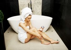 Woman with cosmetic cream in bathroom. Stock Image