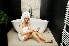 Woman with cosmetic cream in bathroom. Royalty Free Stock Photos