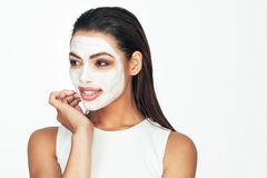 Woman with a cosmetic facial mask royalty free stock images