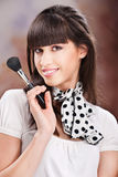Woman and cosmetic makeup. Young pretty girl holding powder brush stock photos