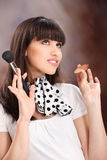 Woman and cosmetic makeup. Happy girl holding powder brush stock photos