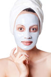 Woman with cosmetic mask Royalty Free Stock Photography