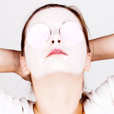 Woman with cosmetic mask Royalty Free Stock Images
