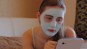 Woman with cosmetic mask on her face stock footage