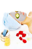 Woman on cosmetic treatmant with mask. Young woman with blue mask lying on the cosmetic table Stock Photography