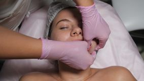 Female beautician does massage stock video