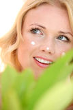 Woman and cosmetics Stock Images
