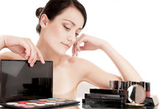 Woman with cosmetics for makeup. Stock Image