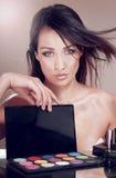 Woman with cosmetics for makeup. Stock Photos