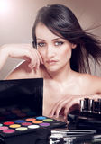 Woman with cosmetics for makeup. Royalty Free Stock Images