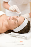 Woman in cosmetics medicine treatment Royalty Free Stock Photography