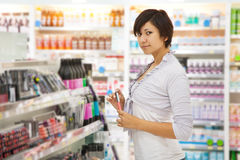 Woman  at cosmetics  shop Royalty Free Stock Photos