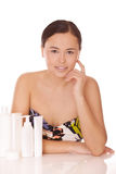 Woman with cosmetics for skincare Stock Image
