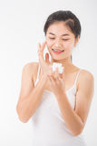 Woman with cosmetics Royalty Free Stock Photography