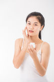 Woman with cosmetics Royalty Free Stock Images