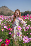 Woman with cosmos flower field Royalty Free Stock Photo