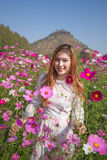 Woman with cosmos flower field Royalty Free Stock Images