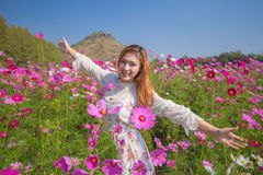Woman with cosmos flower field Royalty Free Stock Photography