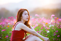 Woman with a Cosmos flower. Stock Photos