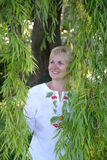 The woman costs among willow branches Stock Photography