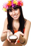 Woman in costume of flowers offer coconut milk Royalty Free Stock Photo