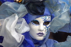 Woman in Costume & Mask. Woman wearing a beautiful costume and painted mask Stock Photo