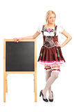 Woman in costume standing by a blackboard Royalty Free Stock Images