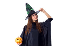 Woman in costume of witch holding a pumpkin Stock Photography