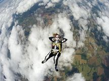 Woman costumed skeleton in free fall. Stock Photos