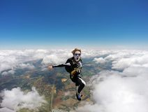 Woman costumed skeleton in free fall. Royalty Free Stock Images
