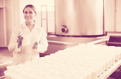Woman on cottage cheese production Royalty Free Stock Photography
