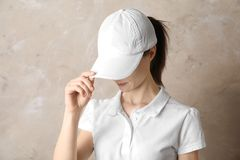 Woman with cotton bag near white brick wall. Mockup for design royalty free stock photos