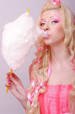 Woman with cotton candy Royalty Free Stock Photography