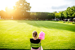 Woman with cotton candy at the park Royalty Free Stock Image