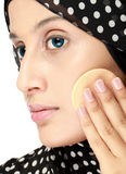 Woman with cotton pad applying face powder Stock Photo