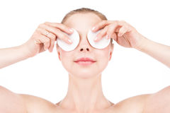 Woman with cotton pad Stock Images