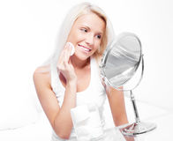 Woman with cotton pads Royalty Free Stock Photos