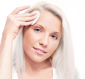Woman with cotton pads Royalty Free Stock Images